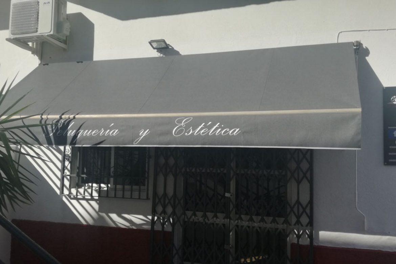 CAMBIO-DE-LONA-PARA-TOLDO-COMERCIAL-CON-NUEVA-ESTÉTICA