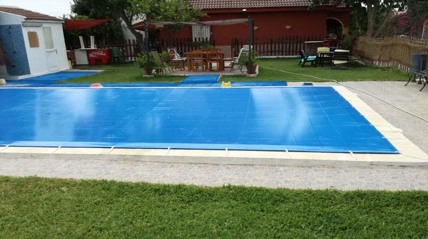 el cubre piscina